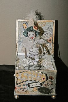 Altered box with doll by Toni Marie--hmmm maybe upcycle box, bed spring, doll, etc.  I may make a primitive version.  Maybe a crank on the side like a jack in the box.