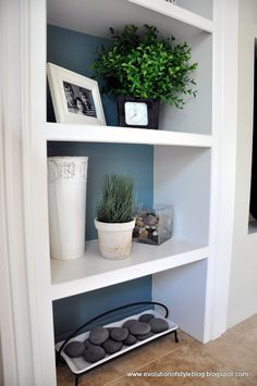 Aegean Teal by Benjamin Moore  you could do this in the dining room nook behind open shelves (built in or purchased)