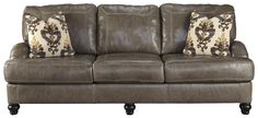 Surround yourself in the transitional style and supreme comfort of this leather match sofa with a queen-size memory foam mattress. It features 100% leather in the on the seat and back cushions with matching polyurethane everywhere else. Coil seat construction adds comfort and durability to the t-style seat cushions. English roll arms and turned feet in a dark finish offer classic design appeal. Completing the luxury of the sofa are two square accent pillows with feather inserts.