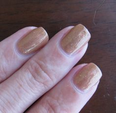 Essence Cookie Love. This is a weird colour, but not quite as unflattering in real life as it looks in this picture.