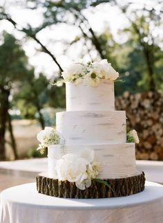 Rustic floral topped wedding cake: http://www.stylemepretty.com/2016/02/01/rustic-waterside-wedding-in-auburn-ca/ | Photography: Joel Serrato - http://joelserrato.com/