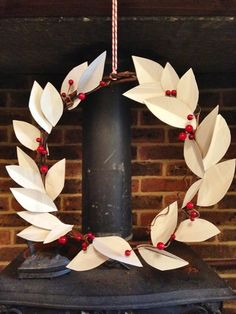 Create your own DIY paper leaf wreath perfect for Christmas decorations and winter weddings