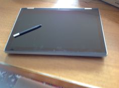 This laptop has a 360 degree flip keyboard and built in stylus!
