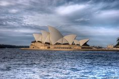 This would have to be without a doubt, the most famous landmark in Australia.     The Sydney Opera House is a multi-venue performing arts centre in Sydney, New South Wales, Australia. It was conceived and largely built by Danish architect Jørn Utzon, opening in 1973 after a long gestation that had begun with his competition-winning design in 1957.     Photo was taken in front of the terminal building in the Rocks.