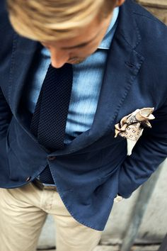 Shades of blue on blazer, button down shirt and tie paired with khaki slacks
