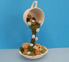 Spring Decor, Easter Centerpiece, Topiary, Floating Cup Spring decoration makes a great centerpiece for a small table, mantle or a cute accent in as a spring or Easter decoration. Could even be used as an all season decoration. Unique Gorgeous Easter Centerpiece. Floating cup