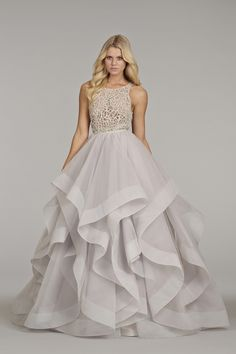 Dress: Hailey Paige Alabaster tulle bridal gown with halter high neck alabaster and crystal bodice, full horse hair flounced skirt and chapel train.