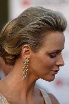 Lovely hairdo is the perfect frame for Princess Charlene's earrings.