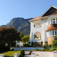 Here you'll be spoiled with spectacular views of the city, gorgeous antique furniture and a perfect location from where you can explore the Mother City. Table Mountain, Antique Furniture, Magic, Explore, Mansions, Luxury, Antiques, House Styles, City