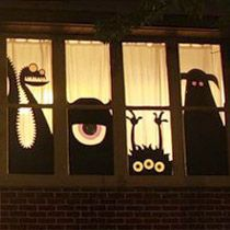 I am doing this next Halloween! Just use black paper, cut the shapes you want, then tape them on the windows