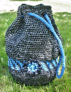 Drawstring bag ~ crocheted VHS plarn and blue plastic bags with loomed flower accent