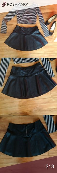 Black Vegan Leather Circle Miniskirt GREAT COND Absolutely adorable! 100% vegan leather look miniskirt. Made by Sans Souci.  Has a lot of flounce and body due to the circle skirt/skater skirt cut. The back has a short zipper for ease in getting into it.   Fully lined. Size L but best fits 8-10 in my opinion.  Top and shoes are available separately in my closet. Sans Souci Skirts Circle & Skater