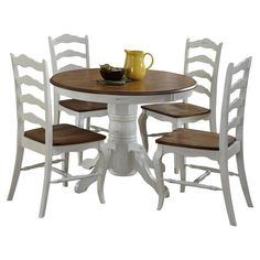 Enjoy Sunday brunch and cocktails with friends around this classic dining set, showcasing 1 round table and 4 side chairs.   Product: