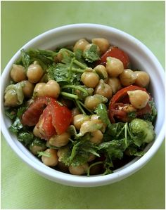 Chickpea salad with cilantro,pesto,cherry tomatoes,salt and pepper  and white wine vinegar