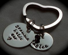 Handstamped & Personalized Key Chain -- Grandma holds our heart. $23.00, via Etsy.