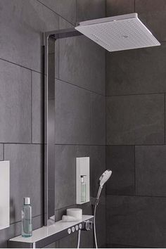Explore large-format dark tiles form the background for the elegant Rainmaker Select E The large overhead shower with white spray disc offers versatile showering indulgence. Experience luxury showers in king-size-format. Grey Bathroom Tiles, Art Deco Bathroom, Bathroom Spa, Bathroom Fixtures, White Bathroom, Modern Bathroom, Decoration Inspiration, Bathroom Inspiration, Shower Holder