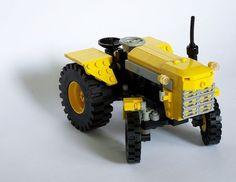 yellow lego tractor                                                       …