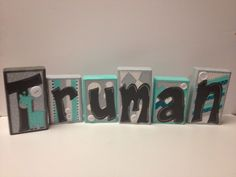 I painted these baby name blocks for a baby boy with a teal and gray nursery theme.....