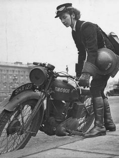 """""""Woman Dispatch Rider Standing Beside Her Motorcycle"""" by Hans Wild.  WWII -- UK?"""