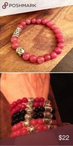 Rhodochrosite Buddha Stretch Bracelet I just love the feel of natural stones. Especially when on my wrist. The energy from them always feels as if it's creeping into the lifeline and to me that's always a good thing especially when Buddha is right there to remind me to breathe and stay in peace and love throughout every moment. This stretch bracelet is made with natural rhodochrosite stones and silver plated beads. The Painted Jezebel Designs Jewelry Bracelets
