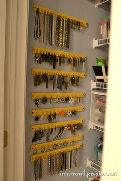 DIY: Hang jewelry/hair ties using PAINT STICKS. Also, use behind kitchen cabinets to hang measuring cups and spoons.