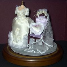 dollhouse miniature dresses | dress on a mannequin created as a copy of her niece's wedding dress ...
