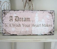A DREAM Is A Wish Your Heart Makes 11 x 5 Shabby Cottage Cinderella Princess Pink or Blue Signs. $21.95, via Etsy.