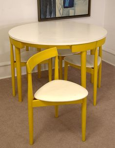 This is what I need for my kitchen!! Compact Dinette Set by Hans Olsen. Sigh...dream on Jen.