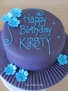 BRIGHT BIRTHDAY CAKE  A deep purple birthday cake with electric blue sugar detailing