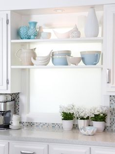 Turn a sunny window into a spot for displaying a collection of your favorite kitchen items. Vintage pieces in a similar color palette are especially lovely when grouped together. Kitchen window shelves are also the perfect location for growing light-loving herbs and flowering plants.