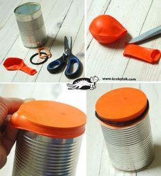 um tambor com reaproveitamento de latas. utillize bixigas exclusivamente de latéx.
