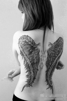 My back is dedicated to my wings. For me, it symbolizes being free, so since I can't have a real set, well why not? :)