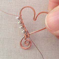 How to wire wrap beads on the outside of a wire frame to make a terrific heart pendant - free tutorial. How to wire wrap beads on the outside of a wire frame to make a terrific heart pendant - free tutorial. Wire Wrapped Jewelry, Metal Jewelry, Beaded Jewelry, Jewlery, Jewellery Box, Silver Jewelry, Jewellery Shops, Amber Jewelry, Celtic Wire Jewelry