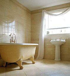 A gorgeous cream-coloured clawfoot tub. CheviotProducts likes this!