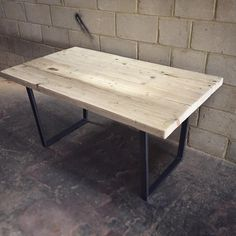 Revive Joiner - Reclaimed wood dining table with tapered steel legs.