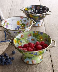 Darling colanders by MacKenzie-Childs® are crafted of enameled steel with bronzed stainless-steel trim and ceramic floral transfers <3