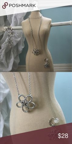 Brighton Silver Flower Necklace Brighton silver flower necklace has a little bling in the center of the flower. Cute with any outfit! Matching earrings and bracelet listed separately. Brighton Jewelry Necklaces