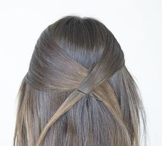 Kate Middleton's Hairstyle - Step 2: Next cross the right section to the left and secure with a bobby pin.
