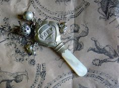 Antique Vintage Baby Rattle Silver Mother of Pearl. $65.00, via Etsy.