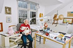 The Mog author Judith Kerr, with her current cat Katinka, in her studio in south west London.