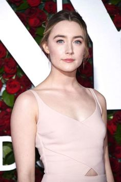 Saoirse Ronan looked flawless and stunning in a nude colored gown with a plunging neckline that teased a hint of her cleavage, a small cut out in the middle that gave a tiny glimpse of her taut midsection and curve hugging design that did full justice to her svelte figure as she posed for the photographs on the red carpet at the 2016 Tony Awards held at the Beacon Theatre on June 12, 2016 in New York City.