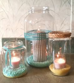 Old pickle jars and such turned into big candle holders. Add Downy Unstoppables to the bottom for a fresh scent and a splash of color. Decorate with rope and ribbon.