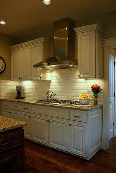 Install white subway tile back splash and under cupboards lighting
