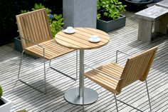 Modern Bistro Table In Teak And Stainless Steel Shown Here With The Tripoli Outdoor Chairs