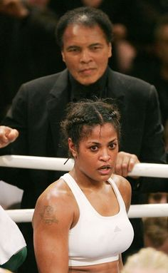 """boxing legend Muhammad Ali (top) smiles as he stands behind his Daughter Laila Ali, after her super-middleweight fight against Asa Sandell of Sweden in Berlin December 2005 """"beat that bitch ass baby"""" Laila Ali, Mohamed Ali, Black Love, Black Is Beautiful, Kickboxing, Photo Star, Float Like A Butterfly, Black History Facts, Sports Illustrated"""