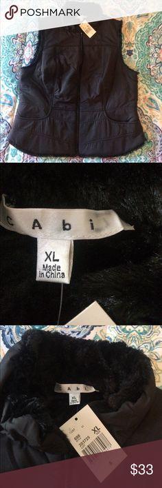 NWT CAbi vest NWT. Black zip vest with pockets. See ink mark on inside label. Length is 23 bust 40. CAbi Jackets & Coats Vests