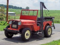 """Jeep Willys CJ-2A """"Agri-Jeep"""" with dually rear tires and K & K side-mounted sickle bar mower."""