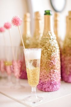 More glitter inspiration: Use spray adhesive & glitter to make inexpensive bottles of champagne look festive and fabulous.