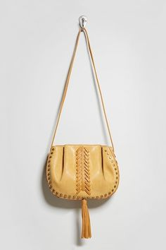 0de9e5c6be A faux leather bucket bag by Lionel™ featuring a lace-up design on the  front and sides