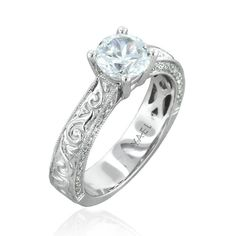 Lush 18k white gold vintage style engagement ring for a one carat diamond, accented with 0.25 carats of ideal cut diamonds.